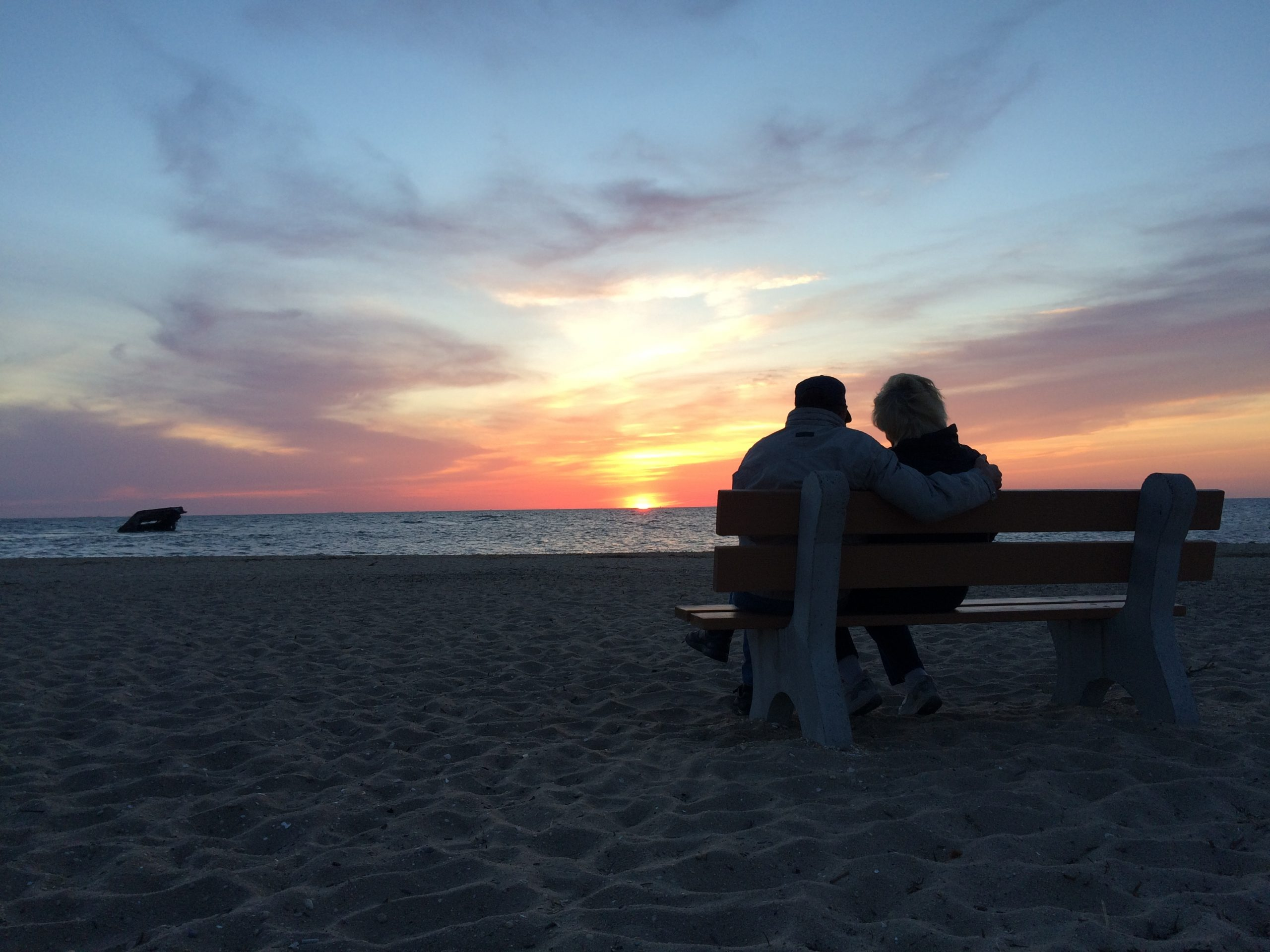 couple on bench on beach