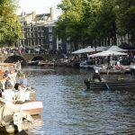people on bridge in amsterdam