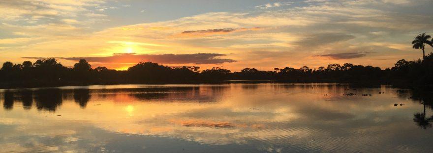 sun setting over lake in florida