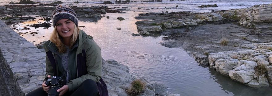sitting on a ledge at sunset in kaikoura