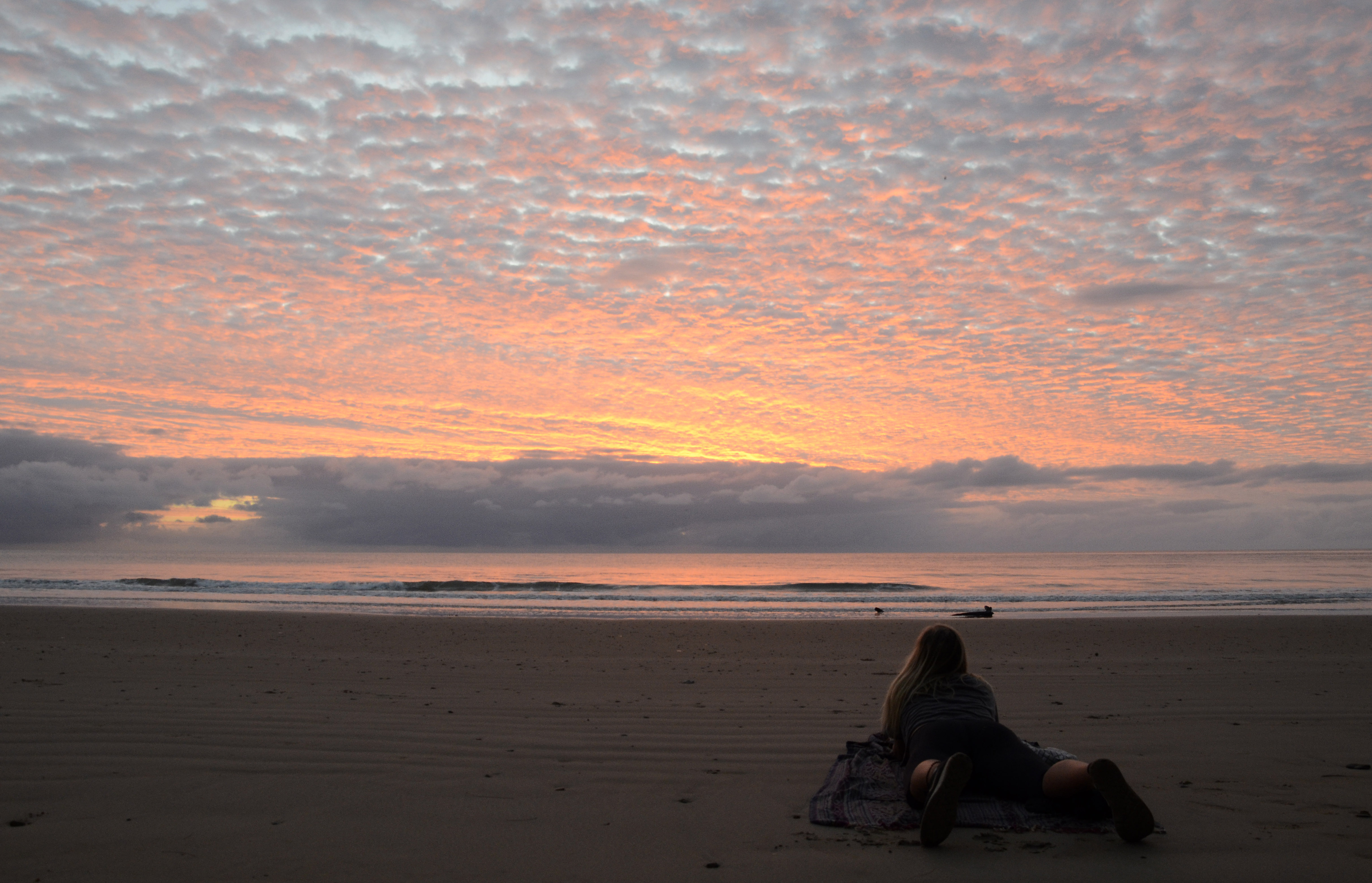 bright red sunrise on beach