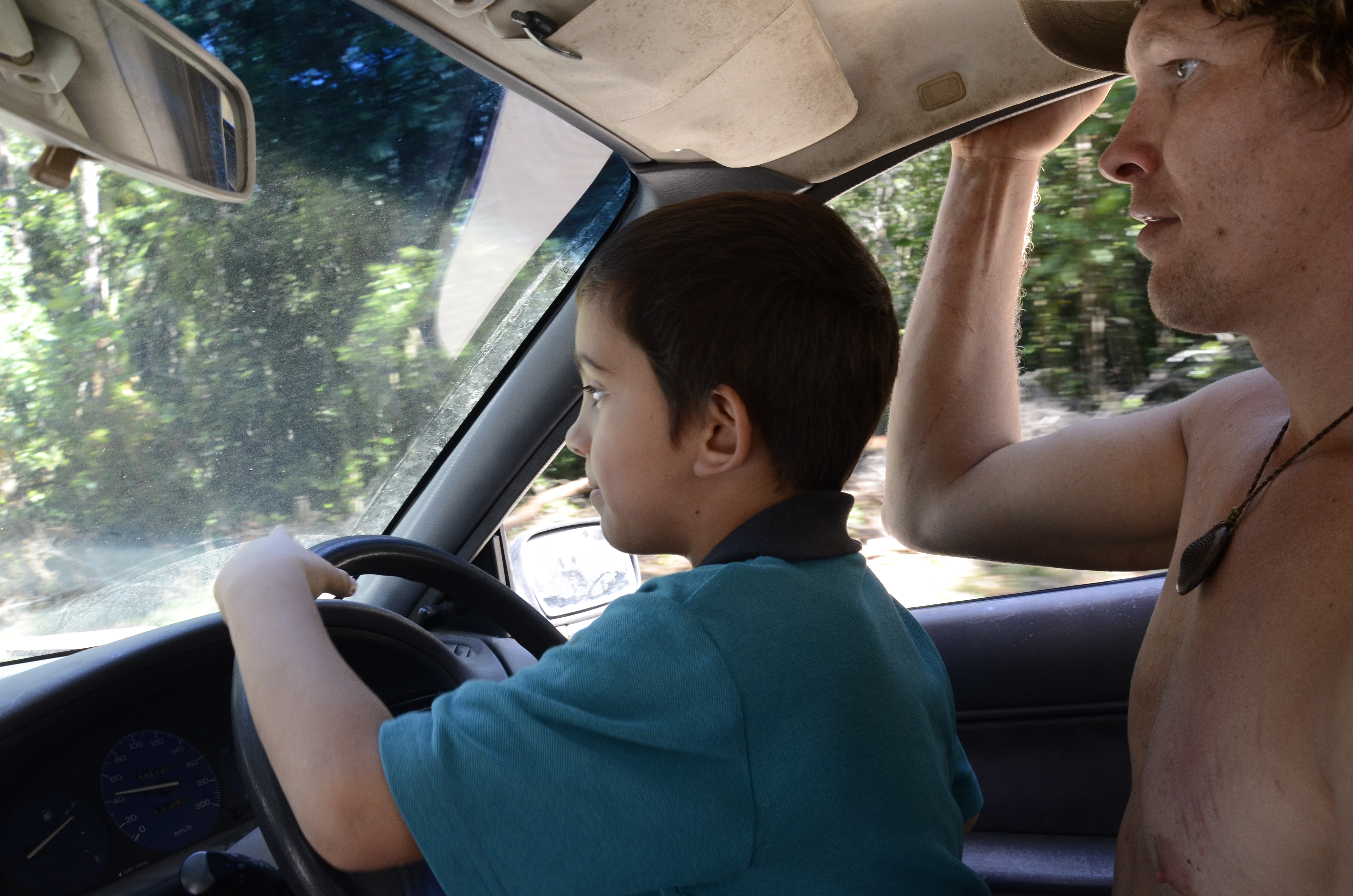 father and son driving car