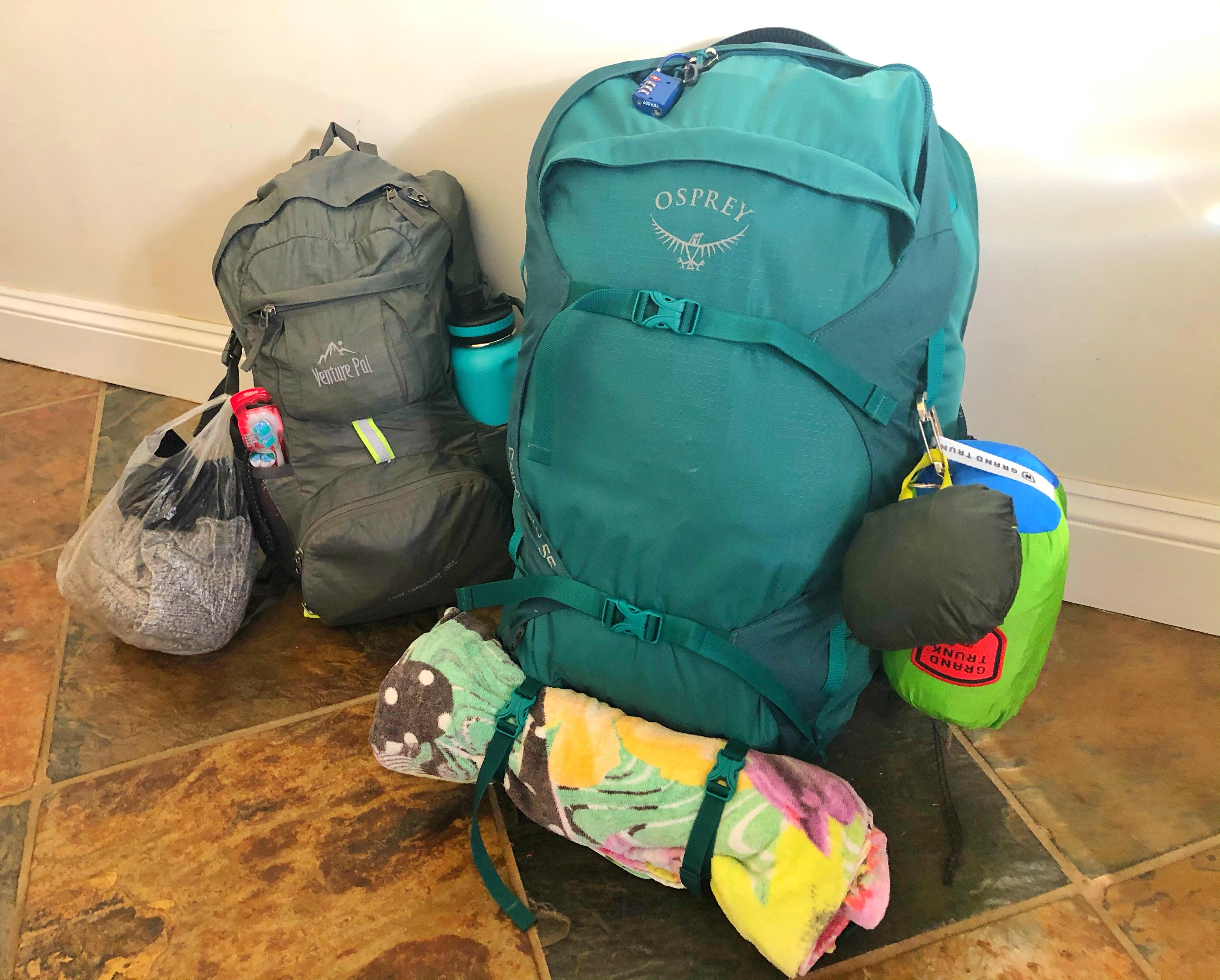 two backpacks sitting on the floor