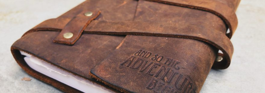 leather journal sitting on a table