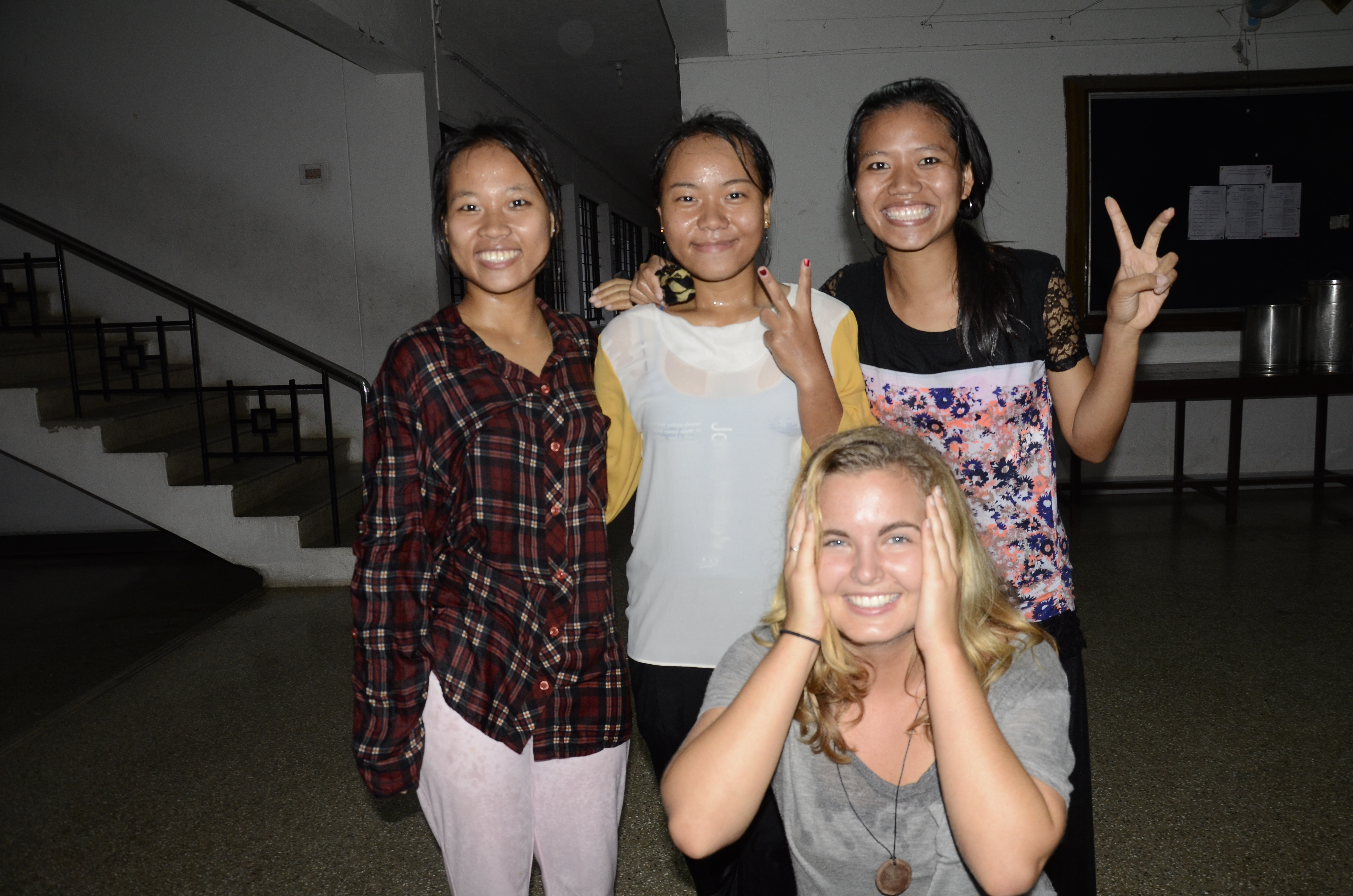 three indian girls drenched from the rain and me laughing