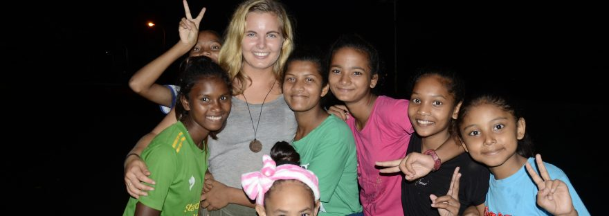 me posing for a picture with some of the girls from the orphanage