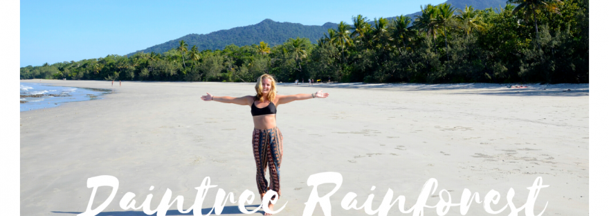 girl standing on beach with 'daintree rainforest' text in foreground